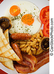Traditional english breakfast, fried bacon, eggs, sausage,...