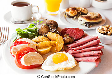 Traditional english breakfast with egg, bacon, mushrooms and tea
