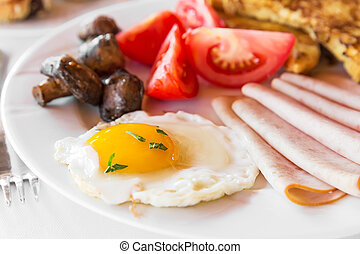 Traditional english breakfast with egg, bacon, mushrooms