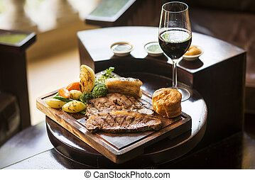 traditional english food sunday roast lunch in restaurant -...