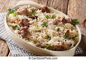 Traditional Estonian festive dish of pork, barley and sauerkraut closeup on the table. horizontal