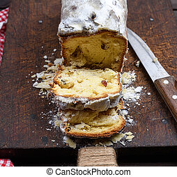 traditional European cake Stollen with nuts and candied fruit