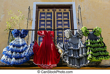 Traditional flamenco dresses at a house in Malaga, Andalusia, Sp