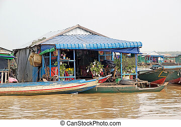 Cambodia - Traditional floating house on the Tonle Sap lake,...