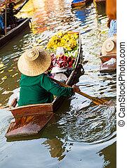 Traditional floating market in Damnoen Saduak near Bangkok. ...