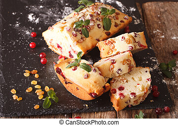 Traditional fruit cake with cranberries and raisins close-up. horizontal