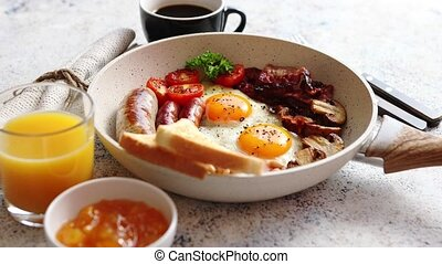 Traditional Full English Breakfast on frying pan. -...
