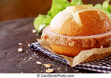 Traditional German meat loaf on a fresh crisp roll