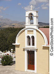 Traditional greek church with graveyard. Crete. Greece
