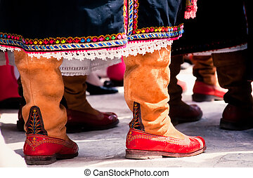 Traditional Greek cloths, dress and leather shoes