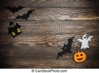 Traditional Halloween characters made of felt. Wooden background. Halloween handmade.
