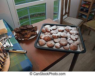 Traditional Hanukkah doughnut suganuyot and potato latkes
