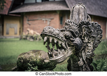 Traditional hindu statue of dragon's head in the garden in ...