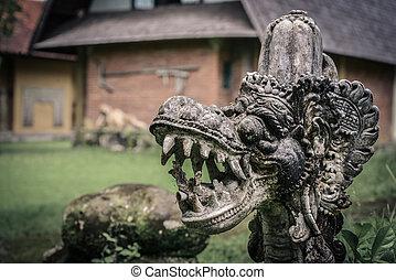 Traditional hindu statue of dragon's head
