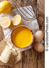 Traditional hollandaise sauce with ingredients eggs, lemon, ...
