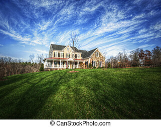 Traditional Home and Large Yard - Wide angle view of a ...