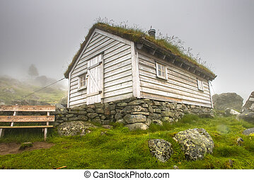 Traditional House with grass roof in Norway