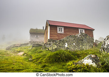 Traditional House with grass roof in Norway, rainy weather