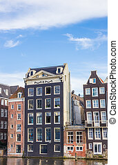 Traditional houses at the Damrak in Amsterdam