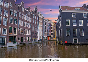 Traditional houses in Amsterdam in the Netherlands at sunset