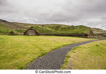 Traditional Icelandic house with mossy roof - Pjodveldisbaer