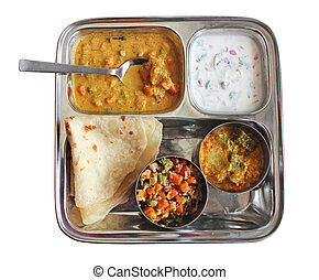 Traditional Indian bread chapati with curries, raitha and...