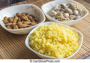 Traditional Indian Pongal, Makar Sankranti rice, nuts, ...