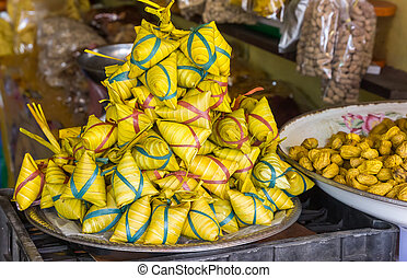 Ketupat rice packets wrapped in palm leaves - Traditional...