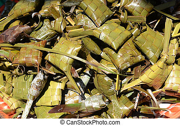 Traditional Indonesian Ketupat rice packets wrapped in palm...