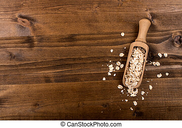 traditional irish raw oatmeal in a wooden shovel