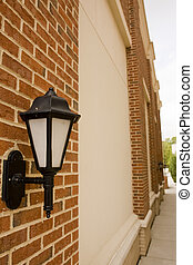 Traditional Iron Lamp on Brick Columned Wall