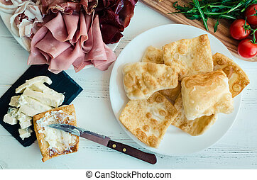 Traditional Italian appetizer crescentine fritte
