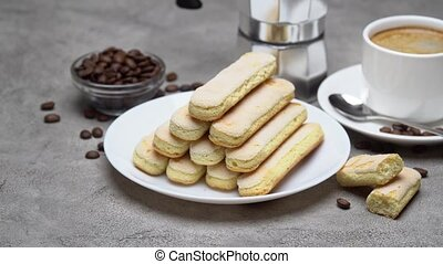 Italian Savoiardi ladyfingers Biscuits and cup of coffee on...