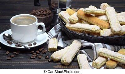 Italian Savoiardi ladyfingers Biscuits in basket and coffee...