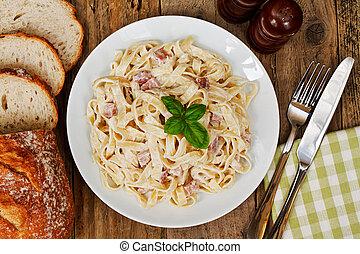 top view of a plate of tagliatelli carbanara italian cuisine in a traditional restaurant setting