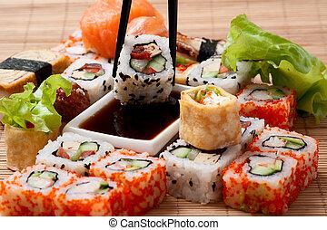 Closeup japanese sushi on a bamboo napkin.