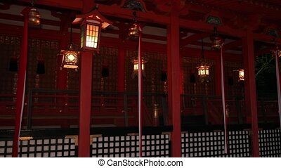 Traditional Japanese shrine with lamps - Japanese shrine in...