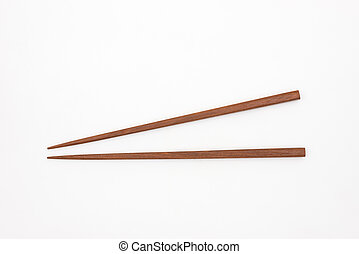Traditional Japanese wooden chopsticks on white background