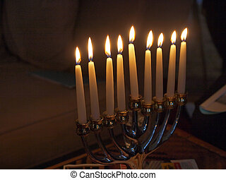 Traditional Jewish Hanukkah menorah with candles with space...