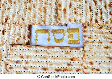 Traditional Jewish Matzo sheet on a Passover Seder table....