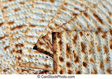 Traditional Jewish Matzo sheet on a Passover Seder table. Passover is a predominantly Jewish holy day and festival. It commemorates the story of the Exodus, in which the ancient Israelites were freed
