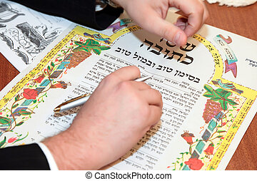 Traditional Jewish wedding, signing prenuptial agreement  ketubah. Jewish marriage contract.