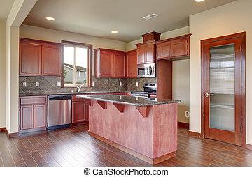 Traditional kitchen with dark hardwood floor.