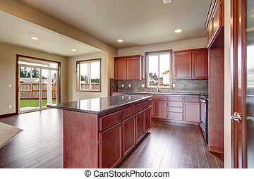 Traditional kitchen with dark hardwood floor.