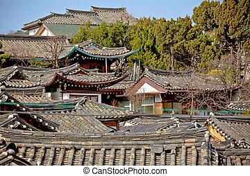 Traditional Korean style roof tops of Bukchon Hanok Village in Seoul, South Korea.