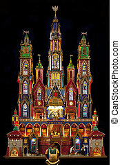 A traditional Krakow Nativity Scene at Christmas in the Franciscan Church in the city of Krakow in Poland. These colorful structures are unique to Krakow. An annual nativity scene contest is held each December in Krakow.