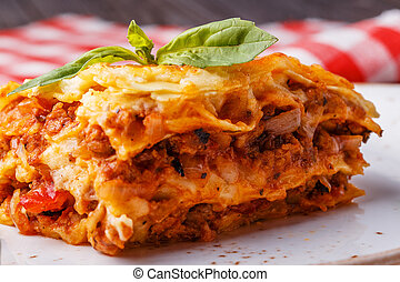 Traditional lasagna made with minced beef bolognese sauce ...