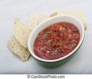 Traditional Latin American mexican salsa sauce with chips
