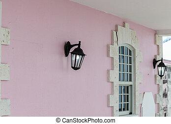 Traditional Lights on Pink Stucco Wall