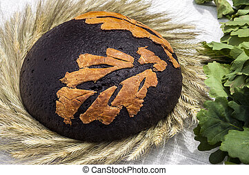 Traditional lithuanian brown bread decorated with rye and ...